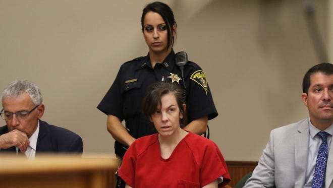Laura Rideout listens during her sentencing.