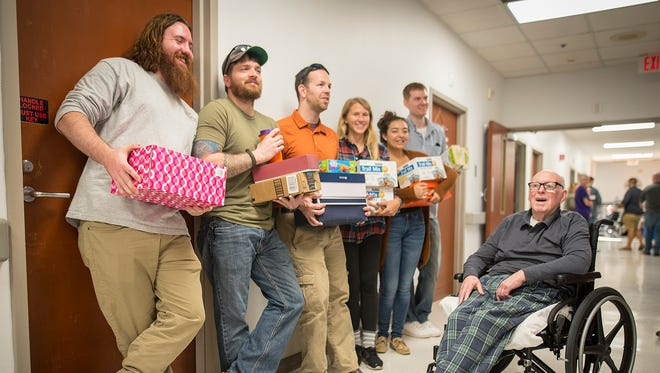 Volunteers with the Clemson University Student Veterans Association deliver care packages at the Richard M. Campbell Veterans Nursing Home in Anderson, S.C., Oct. 21, 2017. This was the second year the CSVA delivered packages to veterans in the home.