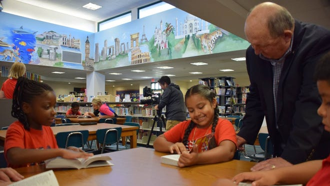 Members of 15 Lee County Rotary Clubs handed out dictionaries to third grade students on Friday, Oct. 27. This is part of the group's annual Dictionary Day celebration.