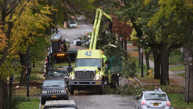 A tree that was blocking a portion of Rosedale Street between Monroe and Pinnacle is removed Monday morning.