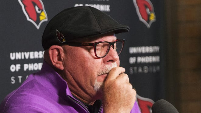 Arizona Cardinals head coach Bruce Arians gets choked up as he announces his retirement to the media at the Tempe training facility January 1, 2018.