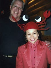 """Dave Weatherholtz, proprietor and director of the OC Jamboree is pictured with Cassidy Van Vonno who played the part of a crab in its production of """"The Little Mermaid Jr."""" Director Paulette DeRosa Matrona and Musical Director Sharon Sorrentino put on the show at OC Jamboree for the Children's Theater of the Ocean Pines Players. Anna Foultz photo"""