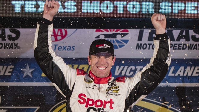 Carl Edwards celebrates his final Cup win - at Texas Motor Speedway last November.