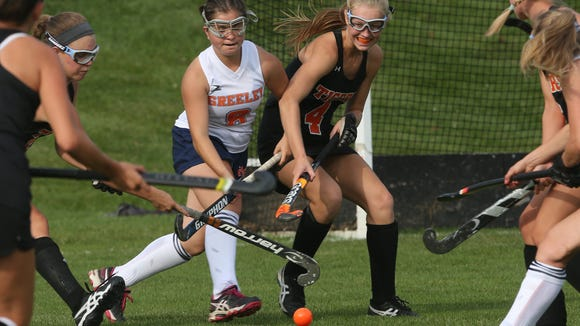 From left, Greeley's Sophie Berkowitz (8) and Mamaroneck's