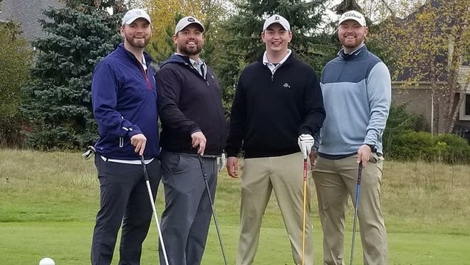 Brothers Dave (from left), Dan, Andy and Matt Smith gear up for last year's golf tournament in memory of their dad, Ken Smith. All four siblings attended Bishop Foley.