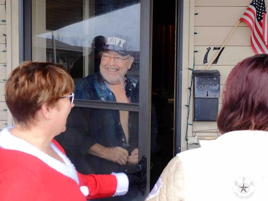 Navy veteran Jamie Fay greeted Gallatin residents as