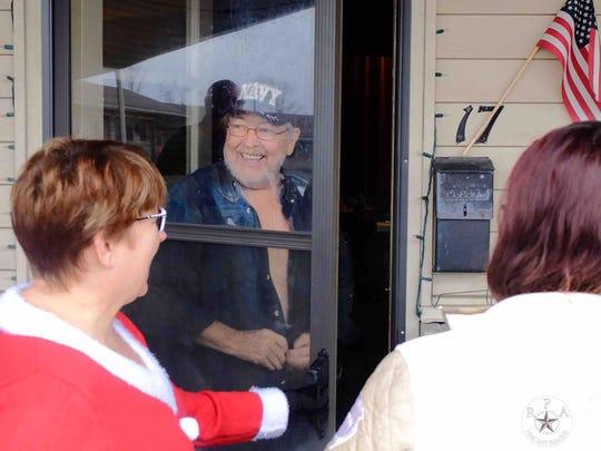 Navy veteran Jamie Fay greeted Gallatin residents as