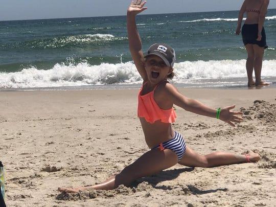 Aubreigh strikes a pose at the beach.