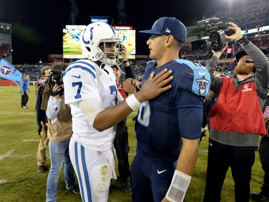 Indianapolis Colts quarterback Jacoby Brissett (7) talks with Tennessee Titans quarterback Marcus Mariota (8) after an NFL football game Monday, Oct. 16, 2017, in Nashville, Tenn. The Titans won 36-22. (AP Photo/Mark Zaleski)