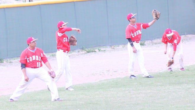 The Cobre High baseball team had some extra warm up time Tuesday because of a bus delay from the Irish.