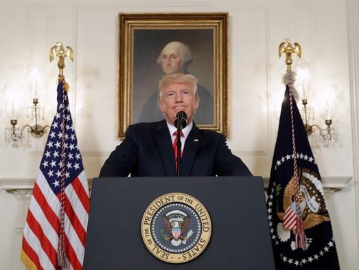 Trump pauses while speaking about the violence in Charlottesville,