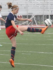 Franklin's Niki Berridge puts her foot into the ball