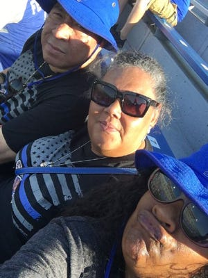 Chuck Allie (left), Ernestine Brower and Suzanne Cooks cheer on Memphis Tiger defensive lineman Ernest Suttles. Brower is Suttles' mother, Cooks became his guardian during high school and both answer to 'Mom.'