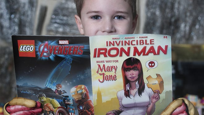 Max Levy, who has hemophilia, poses with Marvel's latest Iron Man comic where he is featured in.