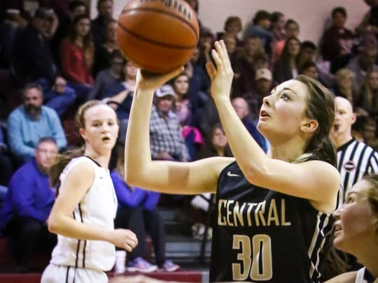 Central Magnet's Abigail Sandman goes in for a layup Friday at Cannon County.
