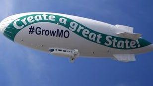 A blimp promoting Grow Missouri circles downtown Springfield on Friday, Sept. 26, 2014.