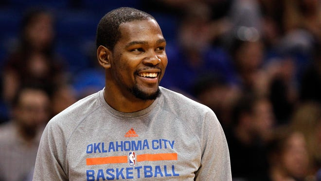Kevin Durant smiles against the Orlando Magic during the second half at Amway Center.