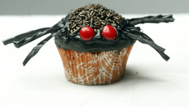 Spooky Spider: Make sure you have a puffy cupcake for this one. Use fudge frosting and chocolate sprinkles for the body, licorice for the legs and Red Hots candies for the eyes.