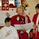 Sister Letetia Rawles, in white, at her ordination ceremony in April. The long-time nun was dismissed from her religious order for violating Catholic teaching when she was ordained as a priest.