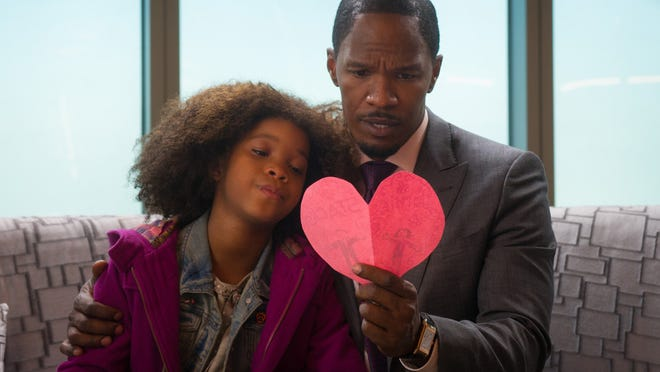 "Quvenzhane Wallis and Jamie Foxx hope for a brighter tomorrow in the musical ""Annie."""
