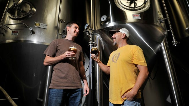 Co-owners of Quest Brewing Co., Andrew Watts and Don Richardson talk about the craft brew industry last fall.