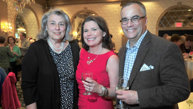 Terry Connolly, center, executive director, is flanked by the evening's two honorees: longtime volunteer Mary Gannon honored with the Caritas Award, and Chris Cannon of Jockey Hollow Bar and Kitchen who received the Community Leadership Award.