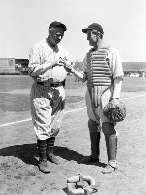 """Former Boston Cubs  pitcher, Mordecai """"Three Finger"""" Brown, left, and catcher, Jimmy Archer, talk things over prior to the start of the Old Timers Game at the World's Fair in Chicago. Ill., Aug. 21, 1933."""
