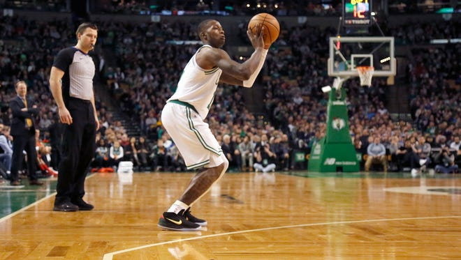 Boston Celtics guard Terry Rozier (12) takes an uncontested three-point shot during the second half of an NBA basketball game against the Atlanta Hawks, Friday, Feb. 2, 2018, in Boston. (AP Photo/Mary Schwalm)