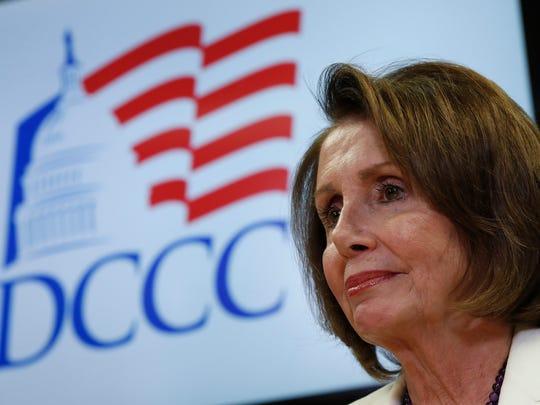 House Minority Leader Nancy Pelosi of California pauses