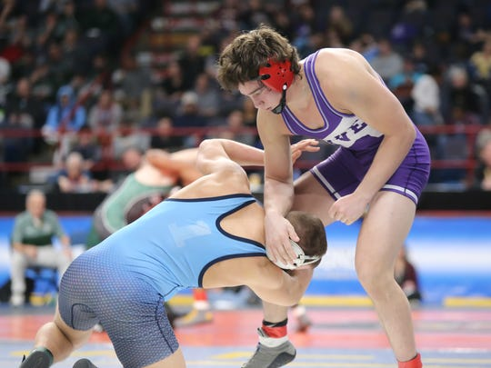 Hilton's Sammy DePrez, right, wrestles in the 182-pound semifinal match of the NYSPHSAA Wrestling Championships at Times Union Center in Albany on Saturday, February 24, 2018.