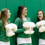 Emily Bliss dances with the Kelly Greens on Thursday during a halftime performance at the Marv Sanders Invite at Scorpion Gym in Farmington.