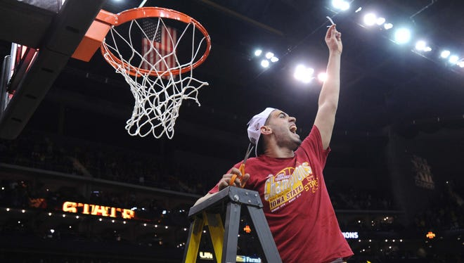 Georges Niang (31) celebrates after cutting part of the net after Iowa State's Big 12 tournament title win over Baylor in March.
