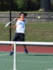 Returning a shot Monday is Plymouth's No. 3 singles player, Kevin Hou.
