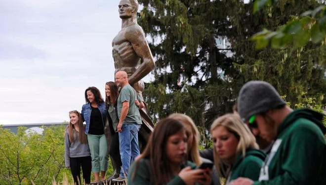 MSU fans gather at the Sparty statue as they get ready for the Spartans to take on Oregon in East Lansing Saturday 9/12/2015.