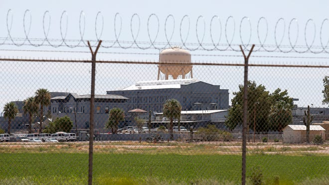 A fence surrounds the state prison in Florence, Arizona