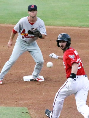 Nick Noonan, right, of the El Paso Chihuahuas, watches as the throw heads to Memphis shortstop Matt Williams at second base, forcing a run down and the eventual tag Tuesday night at Southwest University Park.