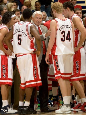 In this Dec. 20, 2006, file photo, Arizona head coach Lute Olson, center, talks to his players, from left to right, Daniel Dillon, Jawann McClellan (5), Chase Budinger (34) and Ivan Radenovic during the second half of a cgame against Memphis in Tucson, Arizona.
