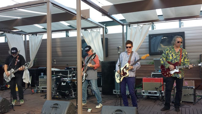 Members of The Baseball Project perform Aug. 16 at Coors Field in Denver.