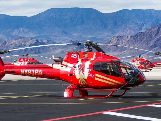 Grounded helicopters sit on the tarmac at the Papillon Grand Canyon Helicopters Boulder City Terminal in Nevada on Feb. 13, 2018, following the fatal crash of a Papillon helicopter in the Grand Canyon