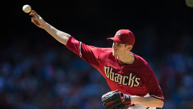 Diamondbacks pitcher Brandon McCarthy throws against the Philadelphia Phillies during the seventh inning at Chase Field in Phoenix, Ariz. April 27, 2014.
