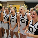 DeWitt High School varsity cheerleaders share a laugh together in the hallways at the school before performing and practicing Monday July 20, 2015. The cheerleaders and coaches will leave for Shiga, Japan Tuesday to perform in the 2015 Japanese High School Cultural Festival.