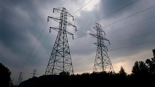 Power transmission lines are showing in Lansing in this file photo.