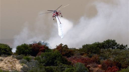 ASSOCIATED PRESS PHOTO Helicopter drop on the Sherpa Fire in Santa Barbara County Friday.