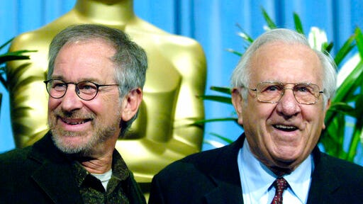 "FILE - Steven Spielberg, nominated for best director for his work on ""Munich,"" left, arrives with his father Arnold for the 25th annual nominees luncheon hosted by the Academy of Motion Picture Arts and Sciences in Beverly Hills, Calif. on Feb. 13, 2006. Arnold Spielberg, a pioneering computer engineer, has died. A family statement says he died Tuesday, Aug. 25, 2020, in Los Angeles at 103."