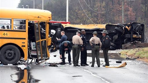 Authorities work the scene of an accident involving two school buses in Knoxville, Tennessee, on Tuesday. Two children and one adult were killed.