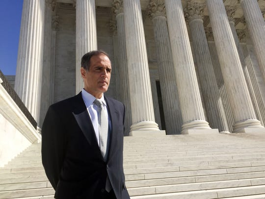Florida resident Fane Lozman stands outside the Supreme Court after attending the oral argument in his free speech case against the city of Riviera Beach.