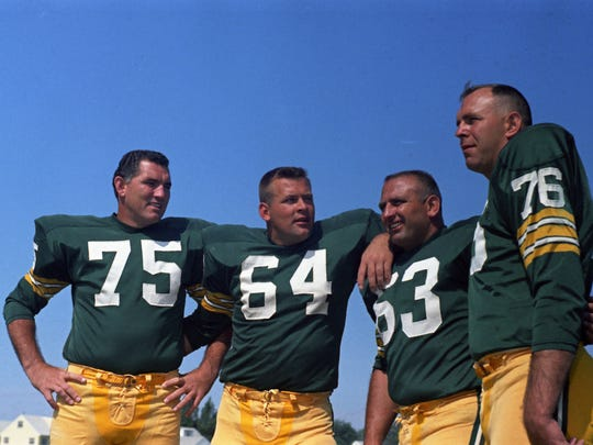 From left, Green Bay Packers tackle Forrest Gregg, guards Jerry Kramer and Fuzzy Thurston and tackle Bob Skoronski at picture day on the team's practice field in 1967. Press-Gazette archives