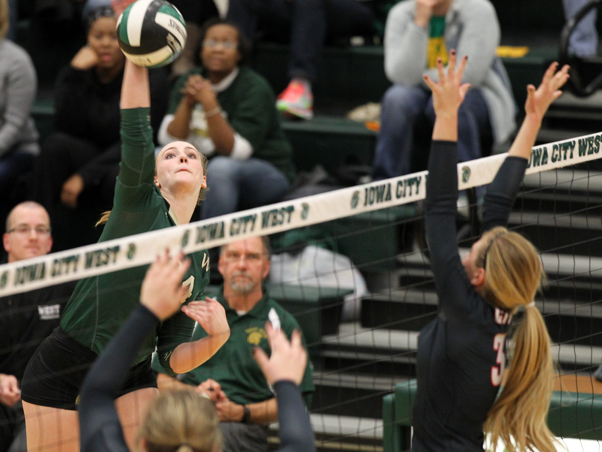 West High's Chandler Haight goes for a kill during the Women of Troy's regional semifinal game against City High at West High on Thursday, Oct. 29, 2015.