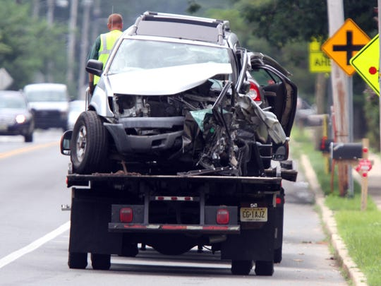 One of the vehicles involved in a fatal collision on Whitesville Road in Toms River is towed from the scene Thursday, July 14, 2016.