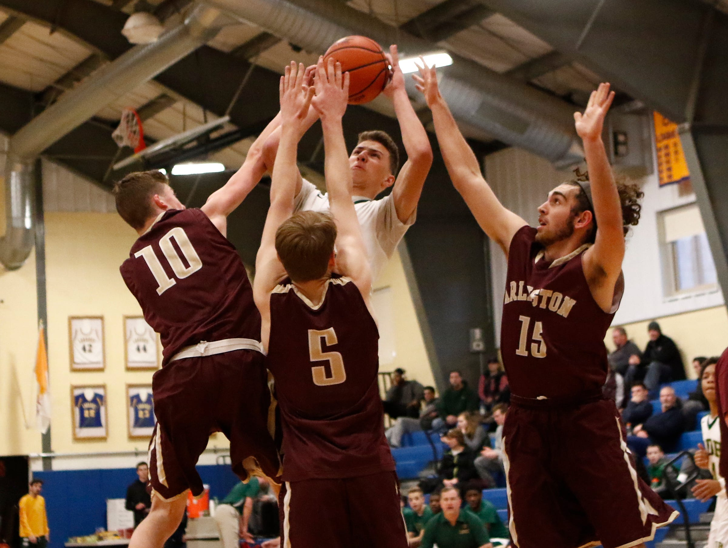 Arlington defenders Dan Duffy, John Smith and Jono Quinn surround a Franklin D. Roosevelt player in the Admirals win in the consolation game of the Duane Davis Memorial Basketball Tournament on Dec. 31, 2016.